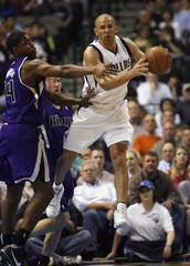 Dallas Mavericks guard Kidd passes the ball out of the lane as he is defended by Sacramento Kings forward Thompson during NBA basketball game in Dallas