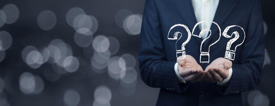 businessman hand  question mark