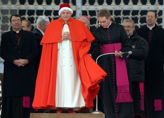 Pope Benedict XVI, wearing the white fur-trimmed red bonnet reserved to Popes and called camauro, ar..