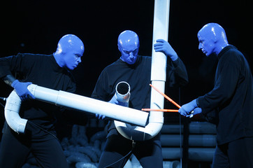 Members of multimedia theatrical Blue Man Group perform during photo opportunity in Seoul