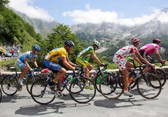Armstrong of the U.S. Landis of the U.S. Rasmussen of Denmark and Ullrich of Germany cycle past ...