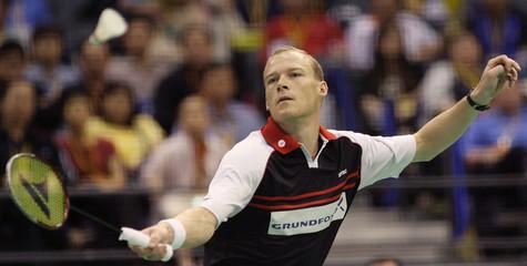 Denmarks Jonassen plays a shot to compatriot Gade in Singapore
