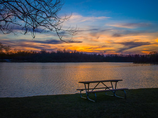 A perfect place to sit and awaken the spirit by a colorful lake during a beautiful sunset