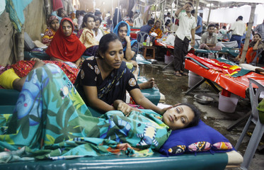 Diarrhoea infected patients lie under a temporary tent which has been set up to house extra patients at a hospital in Dhaka