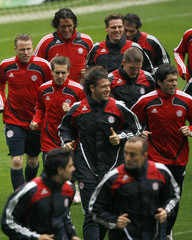 Bayern Munich's players warm up during a training session at Nou Camp stadium in Barcelona