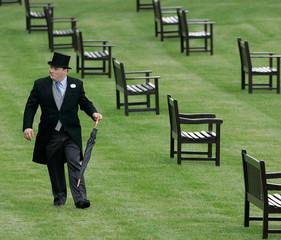 A man walks through the royal enclosure at Royal Ascot at York on the first day of the meeting