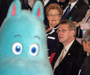 """Finland's PM Vanhanen is welcomed by Finnish cartoon character """"Moomin"""" at World Expo in Nagoya."""