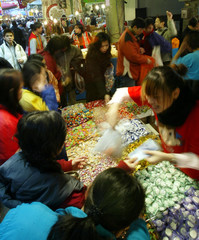 CONSUMERS PICK AND CHOOSE CANDIES ON TIHUA STREET IN TAIPEI.