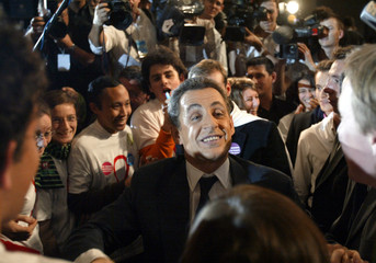 France's Interior Minister Nicolas Sarkozy greets his supporters after leaving a meeting in Angers