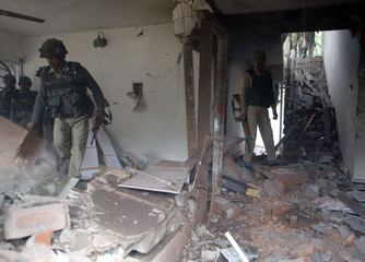 INDIAN SOLDIERS SEARCH DEBRIS AFTER DESTROYING HOUSE IN SRINAGAR.