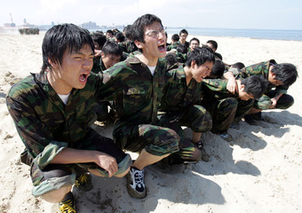 Civilians participate in military training at a temporary camp for civilians organised by South Korean marines in Pohang