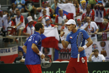 Stepanek and Berdych of the Czech Republic react during their Davis Cup semi-final doubles tennis match against Zovko and Cilic of Croatia in Croatia's northern Adriatic town of Porec