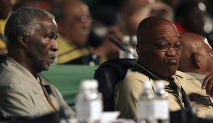 South Africa's President Thabo Mbeki looks on as ANC's Deputy President Jacob Zuma reacts in Polokwane