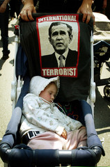 One-year-old Eliza St. Pierre of Quebec sleeps in a stroller during a friendly march to protest the ..