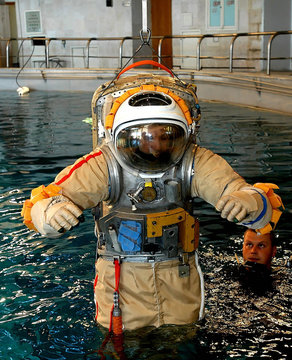 German astronaut Thomas Reiter trains with Orlan space suit, used for work in outer space, in Star ...