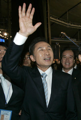 Lee waves to supporters after South Korea's opposition conservative party Grand National Party officially named him as its presidential candidate in Seoul