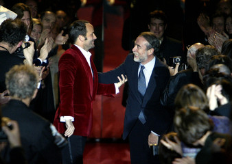 U.S. designer Tom Ford (L) salutes Gucci President delegate Domenico Del Sole (R) at the end of Fren..