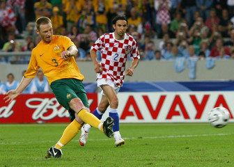 Australia's Moore scores a penalty in front of Croatia's Srna during their Group F World Cup 2006 soccer match in Stuttgart