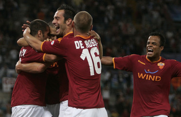 AS Roma's Perrotta is congratulated by his team mates after scoring against Dynamo Kiev during their Champions League soccer match in Rome