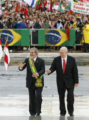Brazilian President Lula and his vice-president Alencar walk up the ramp to Planalto Palace in Brasilia