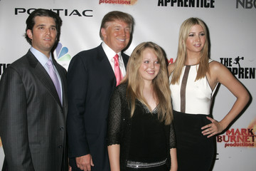 Donald Trump (2nd L), entrepreneur and host of the television reality series 'The Apprentice', poses..