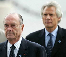 French President Jacques Chirac (L) and French Prime Minister Dominique De Villepin (R) attend a cer..