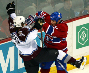 CANADIENS BEGIN COLLIDES WITH AVALANCHES HENDRICKSON.