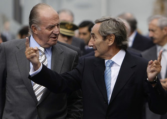 Spain's King Carlos listens to Telefonica CEO Linares during the inauguration of a new Telefonica building in Madrid