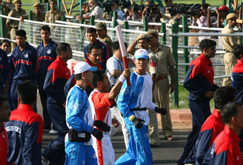A torch bearer holds the Beijing Olympic torch during a relay in New Delhi