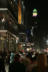 Revelers head home after Mardi Gras celebration ended on Bourbon Street in the French Quarter