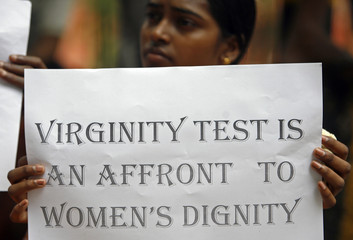 A protester holds a placard during a protest in New Delhi