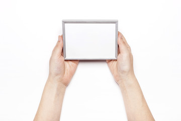 woman hand hold a photo frame isolated white.
