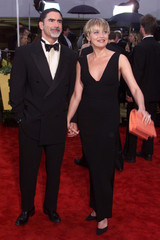 Actress Sharon Stone (R) arrives with her husband, newspaper editor Philip Bronstein, at the 57th An..