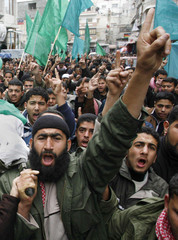 Palestinian Hamas supporters attend the funeral of a Hamas commander al-Shorbasi in the southern Gaza strip