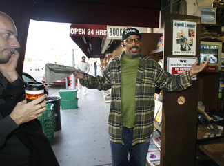 Man reacts to a store that is sold out of  newspaper in Hollywood