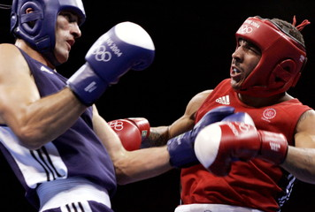 Andre Ward (R) of the U.S. fights Belarus' Magomed Aripgadjiev during the men's light heavyweight (8..