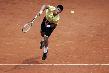 Serbia's Djokovic serves to Spain's Verdasco at the French Open tennis tournament at Roland Garros in Paris
