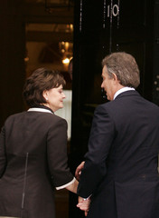 Britain's Prime Minister Tony Blair and his wife Cherie arrive back in Downing Street in London.