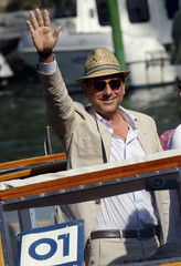 Italian actor Castellitto poses for photographers as he arrives with a water taxi at the 66th Venice Film Festival