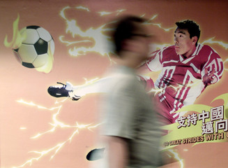 AN ADVERTISEMENT IN HONG KONG CELEBRATES CHINAS ENTRANCE TO THE WORLDCUP FINALS.
