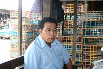 U Shwe Than, chairman of wholesale dealers, sits at the main poultry market in Yangon