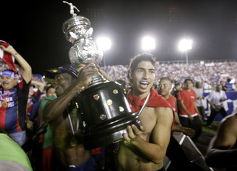 Atlante's players celebrate with the trophy after defeating Pumas to win the Mexican league championship soccer final in Cancun