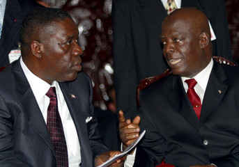 LIBERIA'S INTERIM LEADER BRYANT TALKS TO FORMER PRESIDENT BLAH DURINGINAUGRATION CEREMONY IN ...