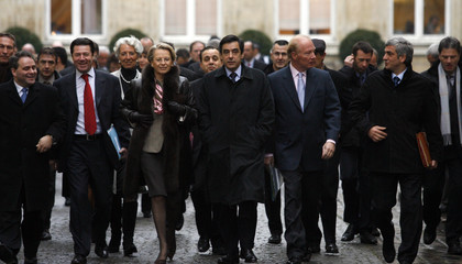 France's Prime Minister Fillon and his ministers leave the Interior Ministry courtyard in Paris