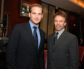 Actor Lucas and producer Bruckheimer pose at a pre-screening cocktail reception in Washington