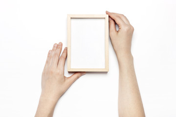 woman hand hold a white photo frame isolated white.