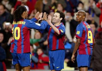 FC Barcelona's Eto'o looks to his team mate Brazilian soccer star Ronaldinho and striker Iniesta ...