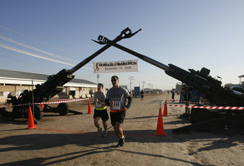 U.S. soldiers take part in the Satellite Honolulu Marathon race in Iraq at a U.S. military camp in Taji