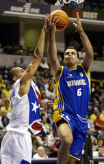 BRAZILS MAZZUCHINI SHOOTS NEAR DALMAU IN FIBA WORLD BASKETBALLCHAMPIONSHIPS GAME WIN.