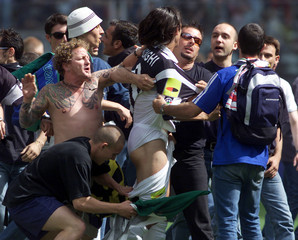 JUVENTUS SUPPORTERS INVADE THE PITCH DURING THE MATCH AGAINST ATALANTA IN THEIR SERIE A SOCCER MATCH ...